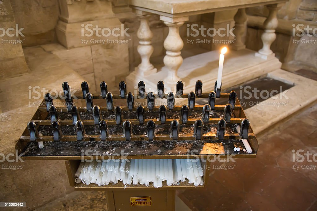 Candle on candlestick Church stock photo