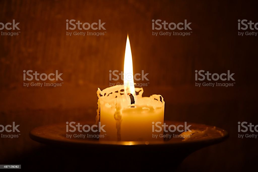 Candle on Fire stock photo