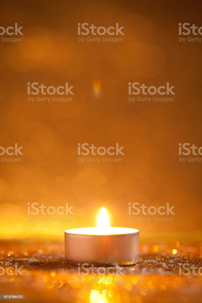 Candle on gold glitter with yellow background stock photo
