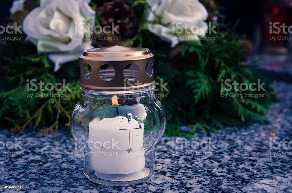 candle on grave stock photo