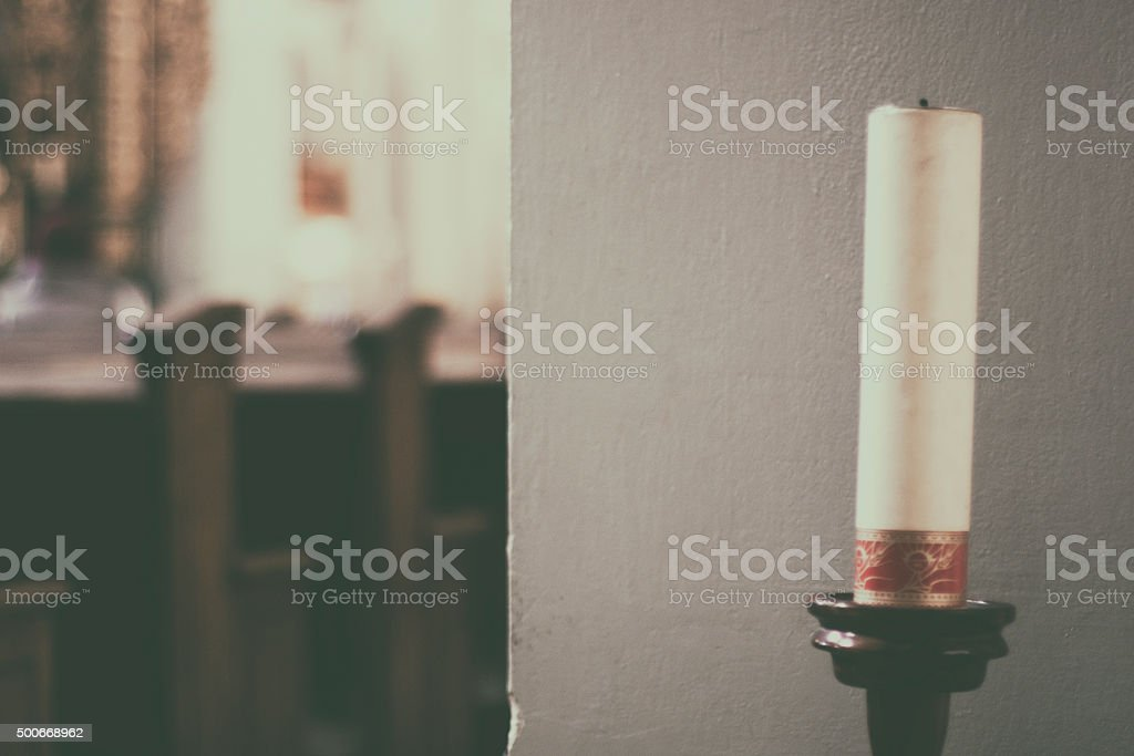Candle on old wooden candlestick, church, monastery, background stock photo