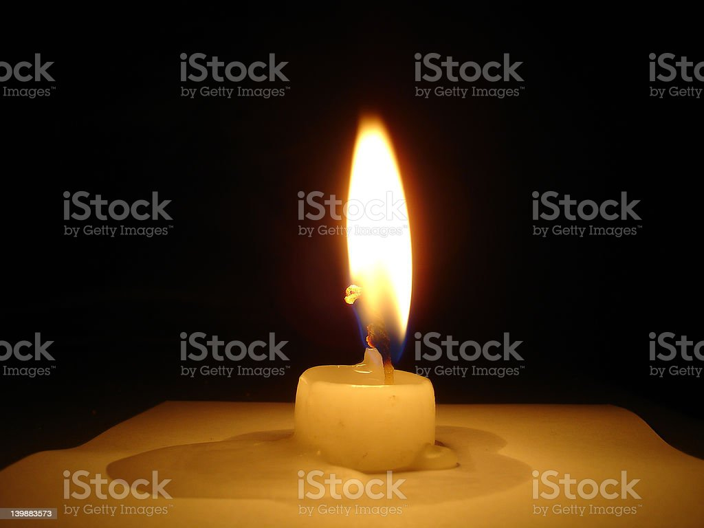 Candle on partchement royalty-free stock photo