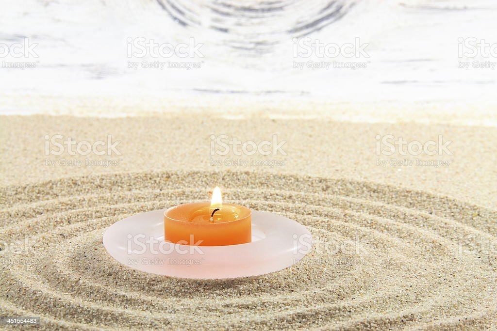 candle on sand stock photo