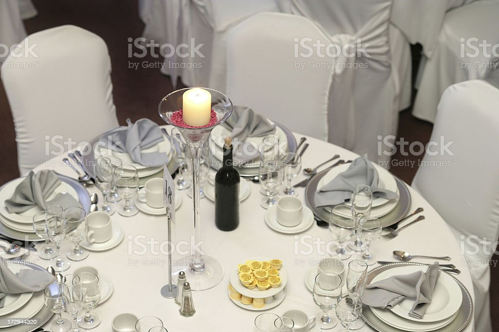 Candle on the guest table royalty-free stock photo