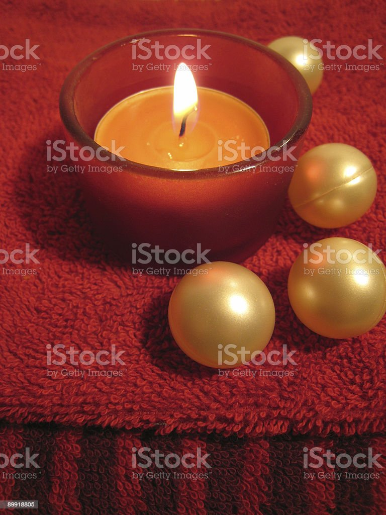 Candle on towel royalty-free stock photo