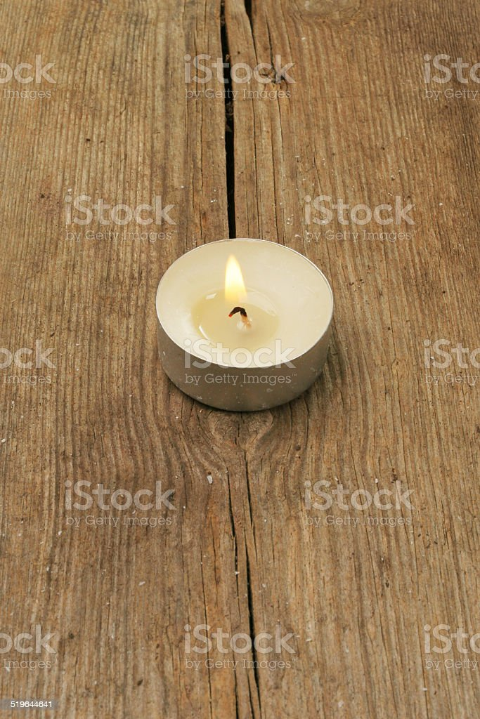 Candle on wood stock photo