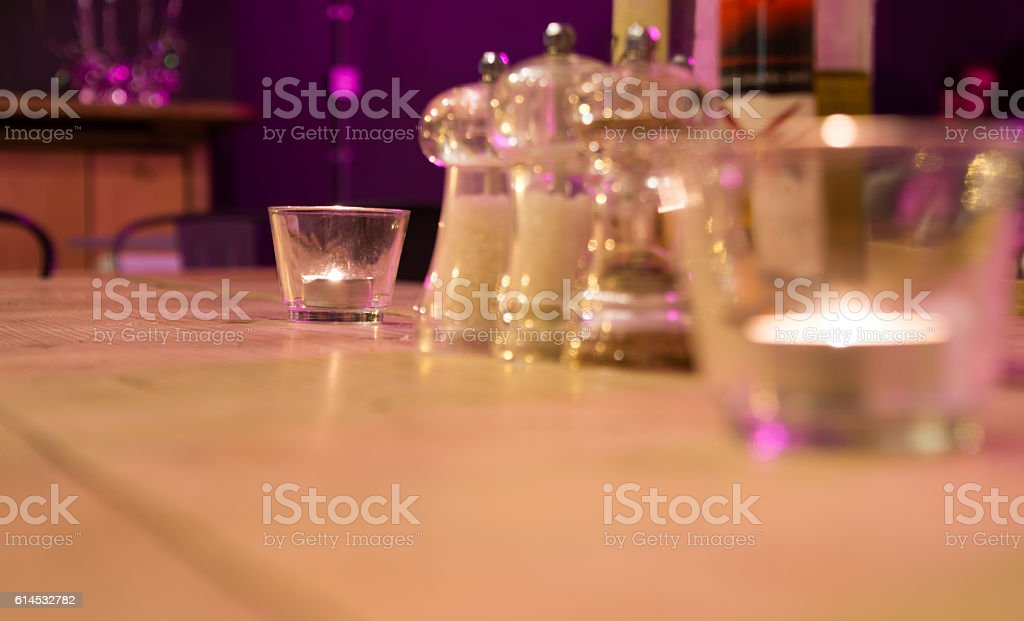 Candle on wooden table in restaurant stock photo