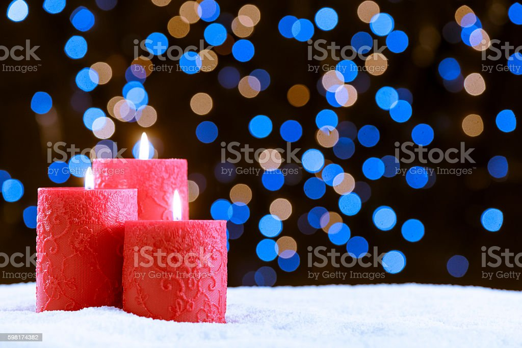 Candle over snow for Christmas stock photo