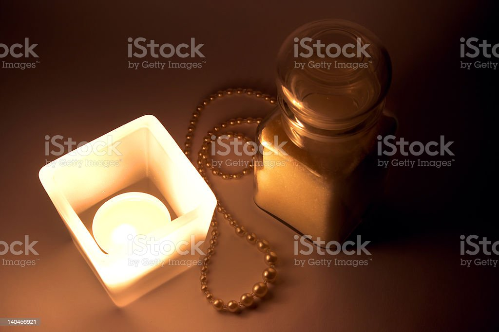 candle, perl necklace and small bottle royalty-free stock photo