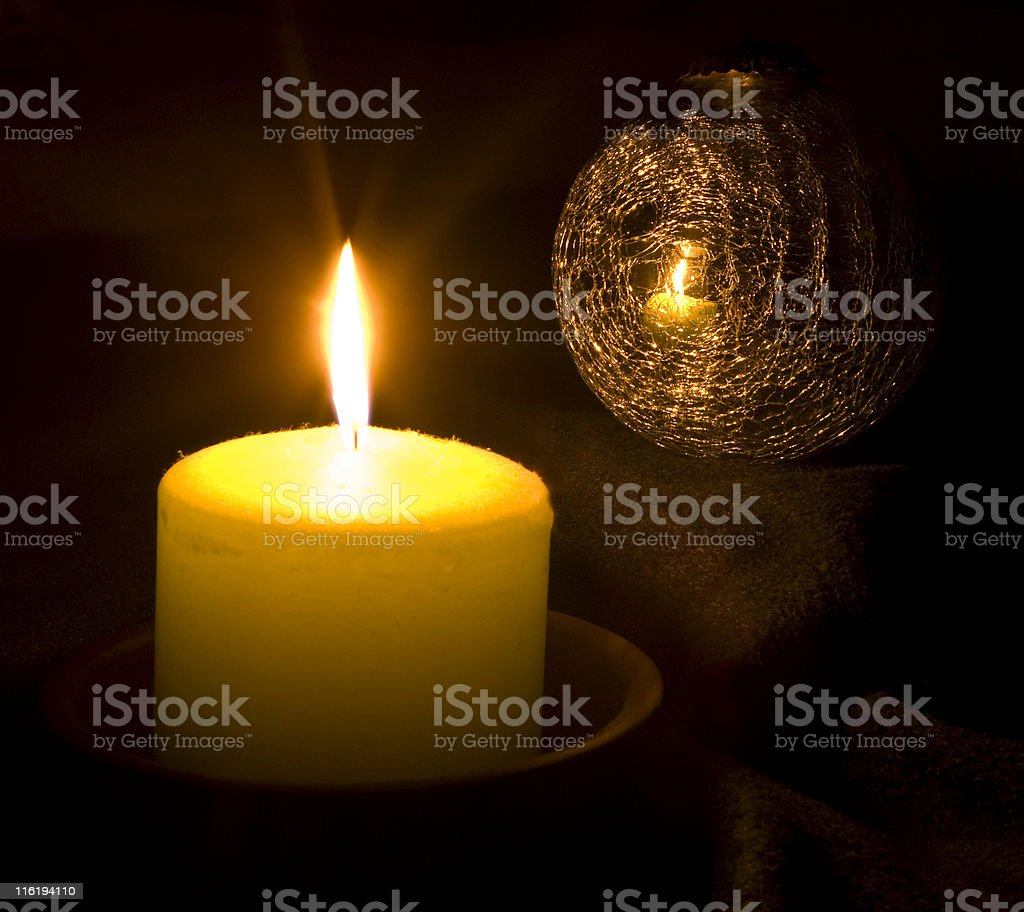 Candle reflecting in a Christmas ball royalty-free stock photo