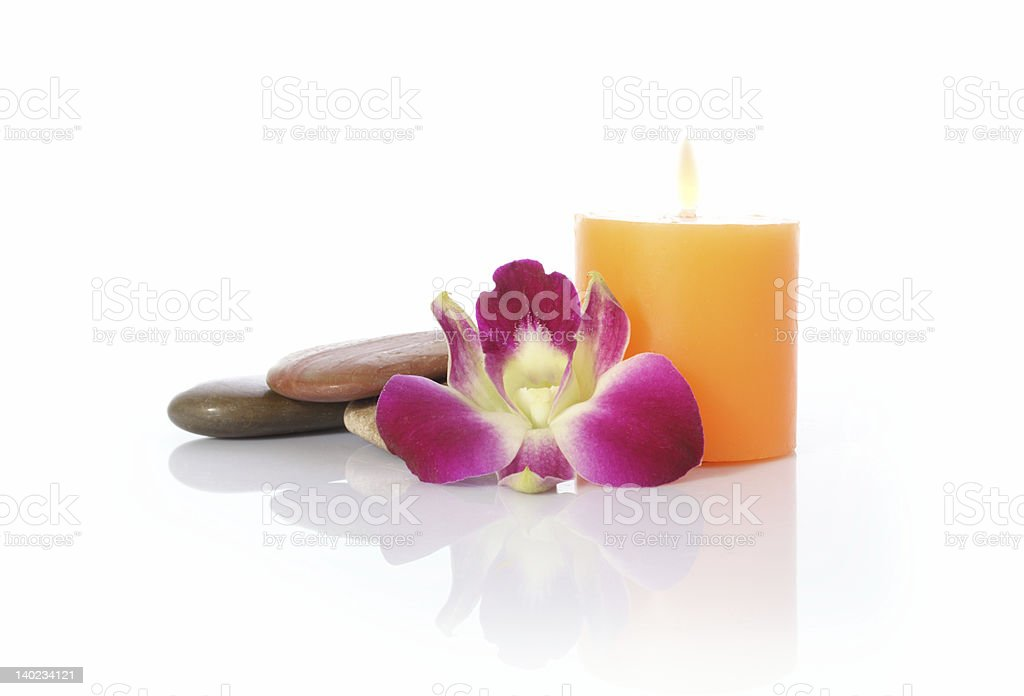 Candle, River Stones and Orchid royalty-free stock photo