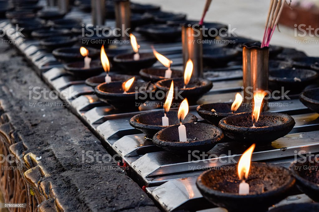 Candle row and light stock photo