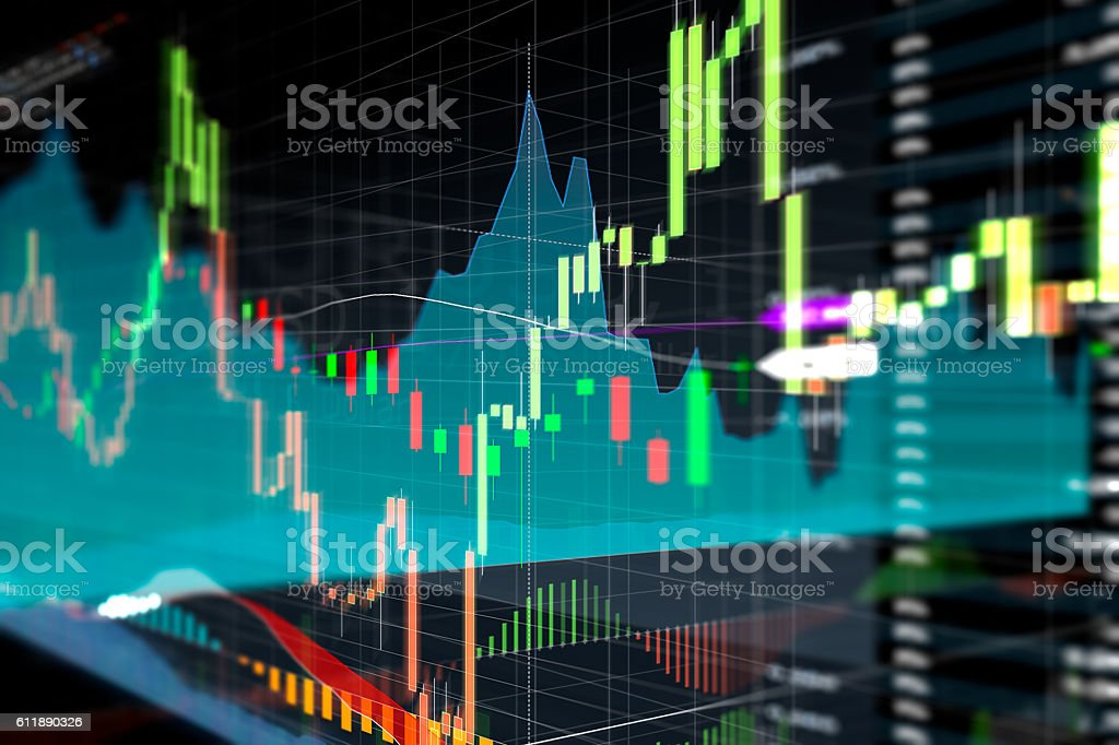 Candle stick graph and bar chart of stock market investment stock photo