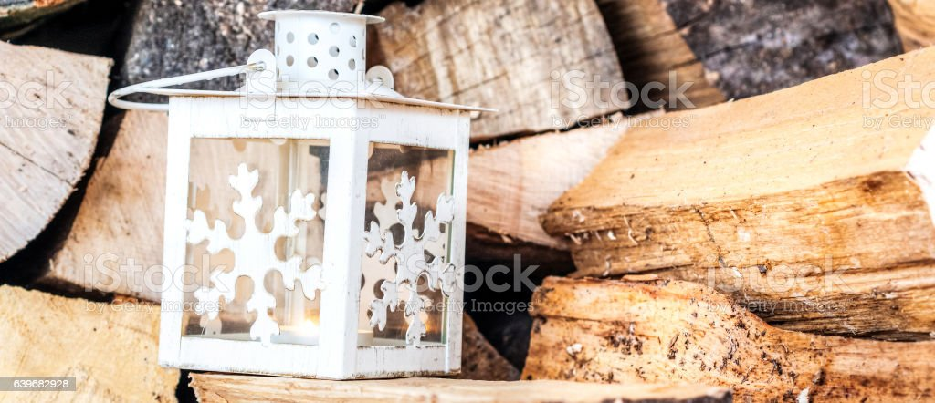 candle stick laying on a pile of firewood stock photo
