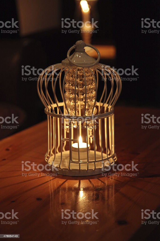 Candle Table Decoration tea light in a cage with reflection royalty-free stock photo