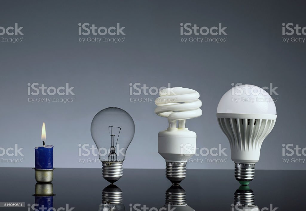 Candle, tungsten bulb,fluorescent bulb and LED bulb stock photo