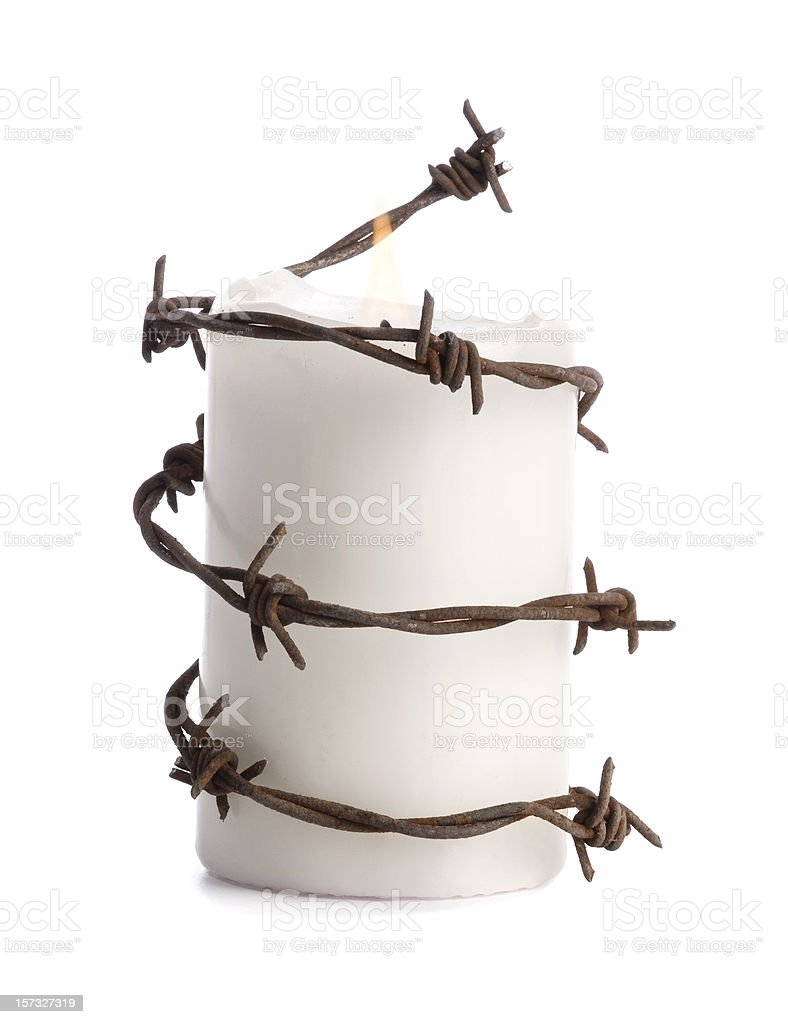 candle with barbed wire stock photo