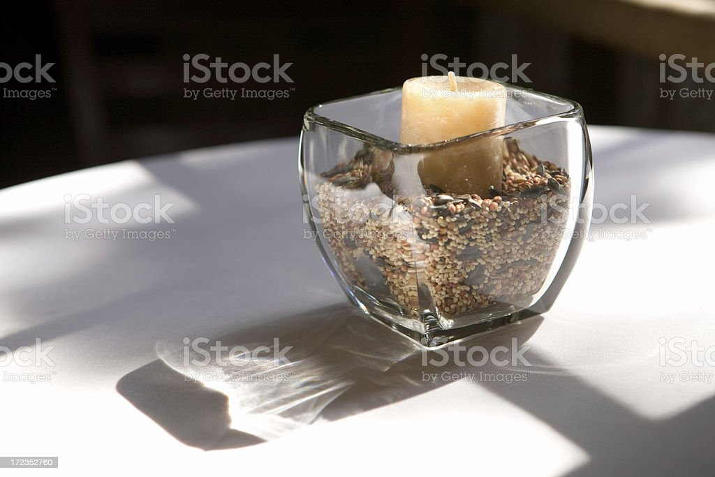 Candle with birdseed royalty-free stock photo