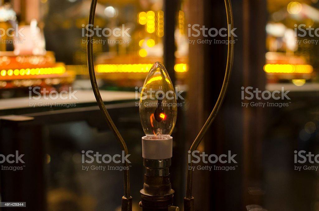 Candle with carousel lit background stock photo