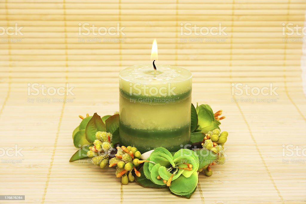 Candle with flowers royalty-free stock photo