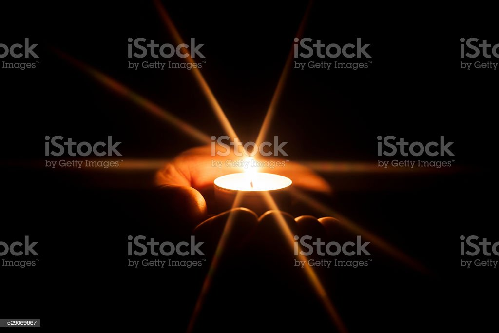 Candle with Glowing Star - Christmas Light Hope Hand stock photo