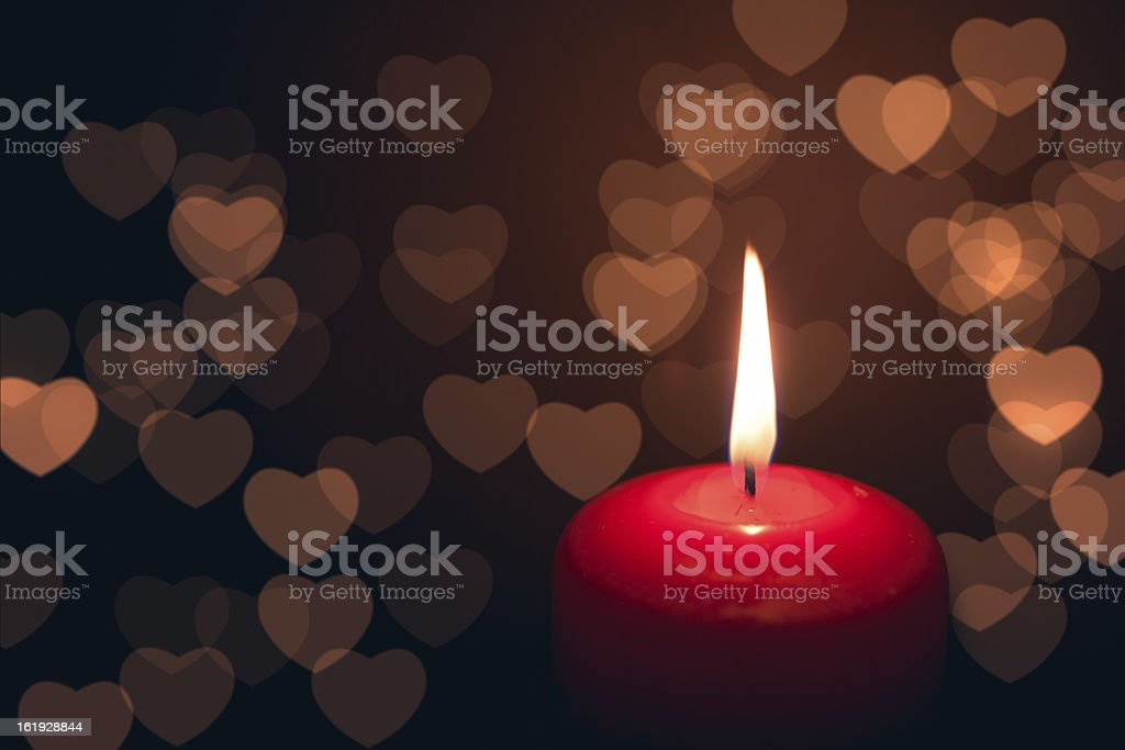 candle with hearts bokeh royalty-free stock photo