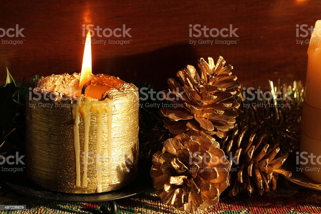 Candle with pine cones royalty-free stock photo