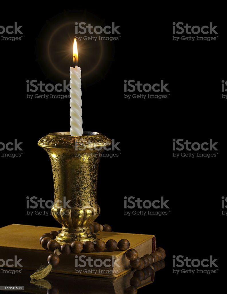 Candle with rosary royalty-free stock photo