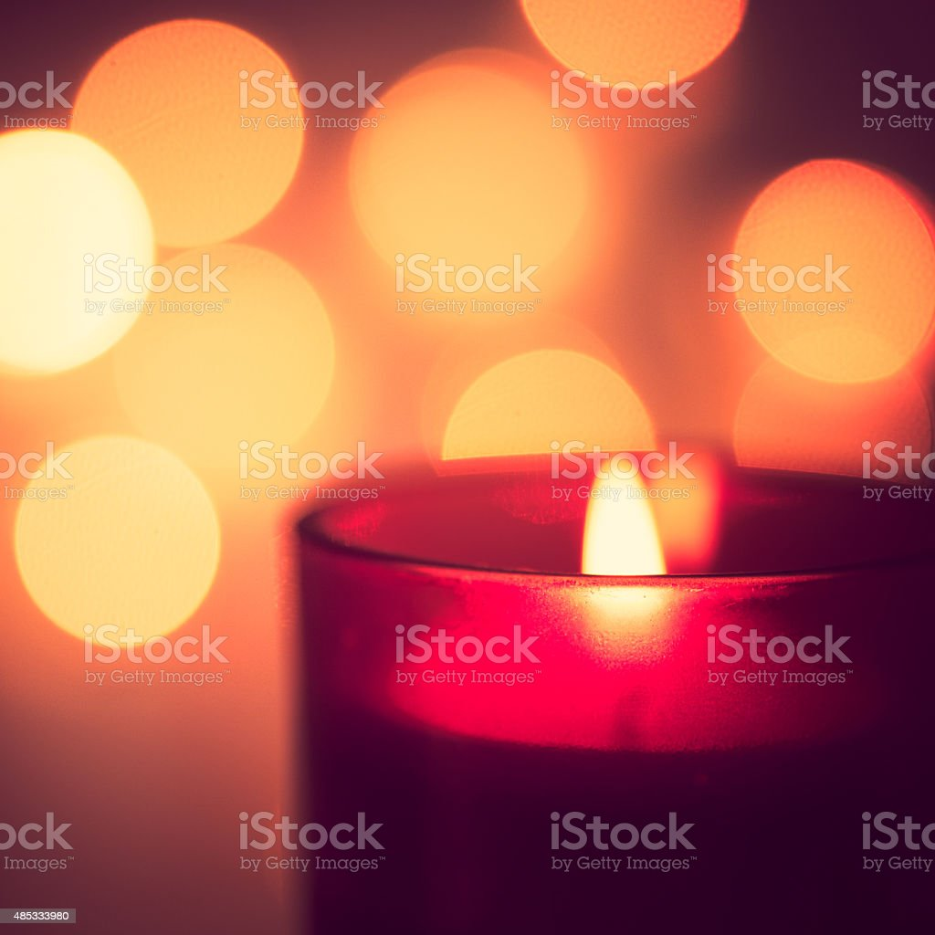 Candle with yellow bokeh stock photo