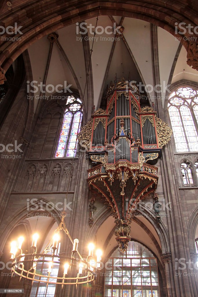 Candleholder and organ of Strasbourg cathedral stock photo
