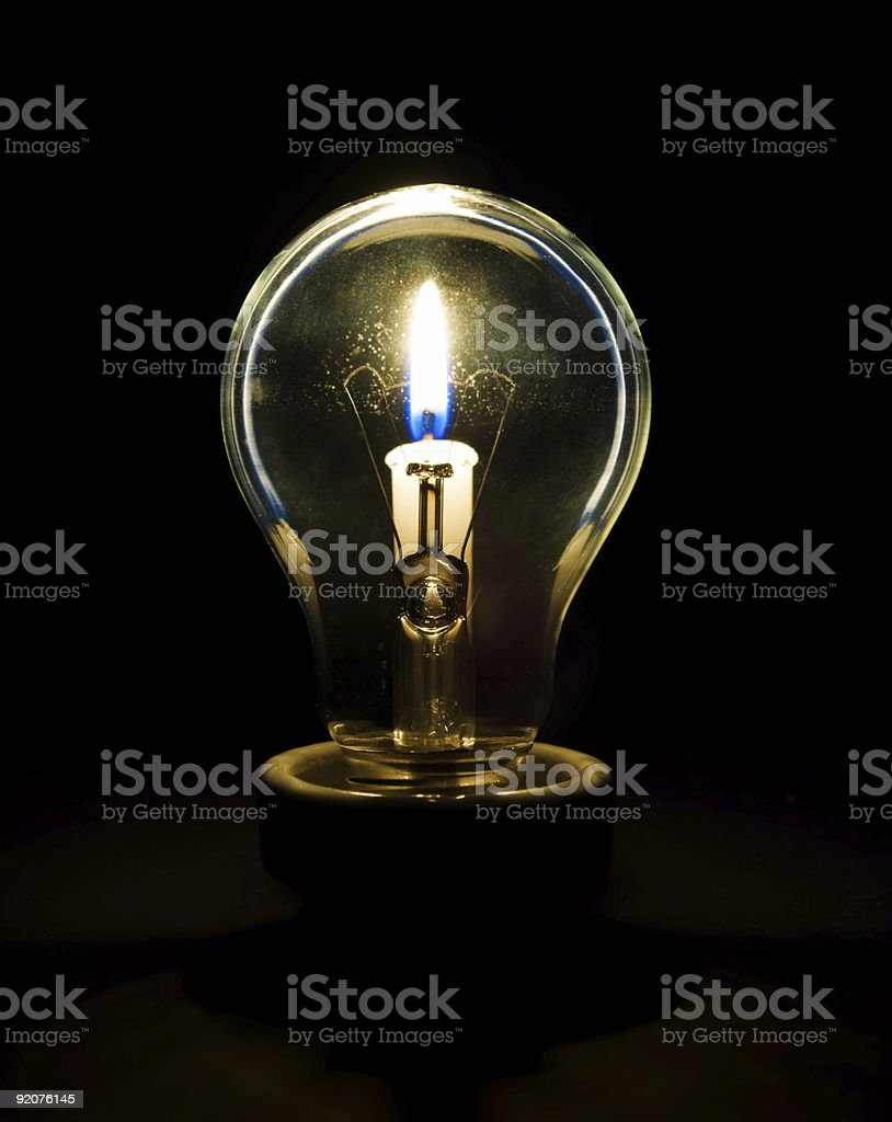 Candlelight in a tungsten-bulb stock photo