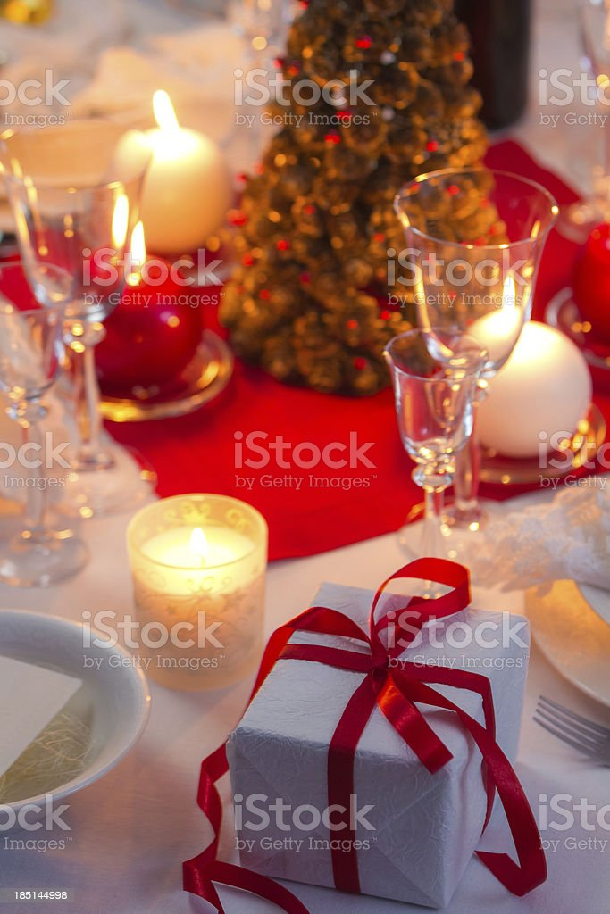 Candlelight on a table decorated beautifully for Christmas royalty-free stock photo
