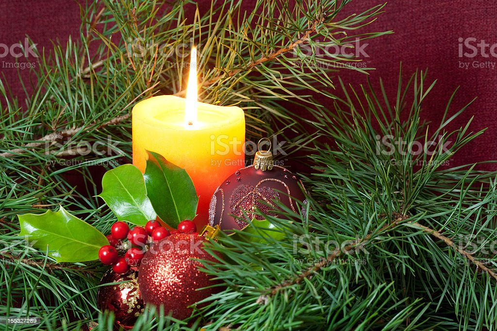 candlelight,holly and bauble royalty-free stock photo