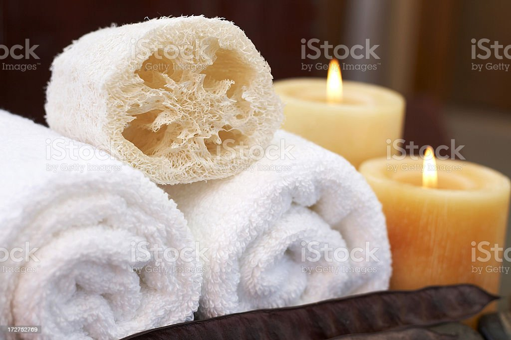 candle-lit towels and loofah royalty-free stock photo