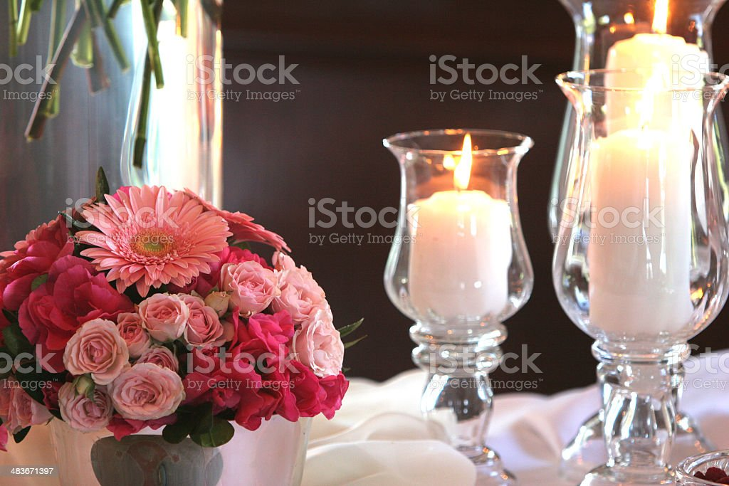 Candles and flower stems stock photo