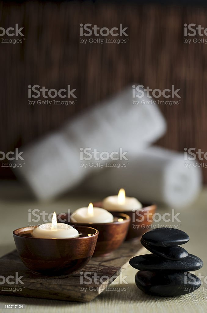 Candles and Massage Stones in a Zen Spa Background stock photo