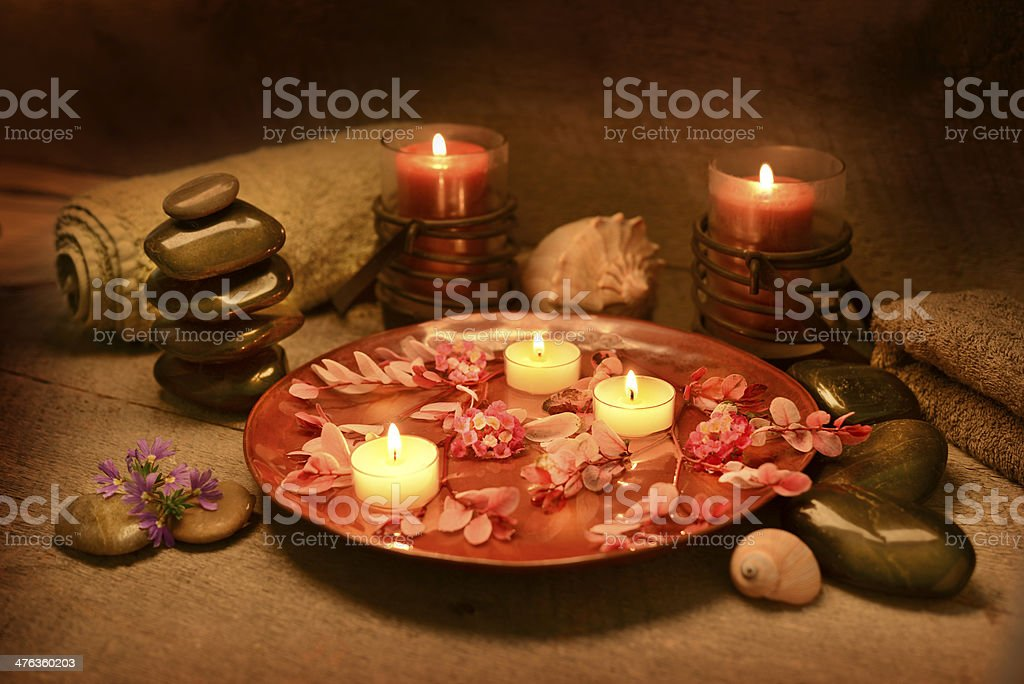 Candles and Massage Stones in a Zen Spa royalty-free stock photo
