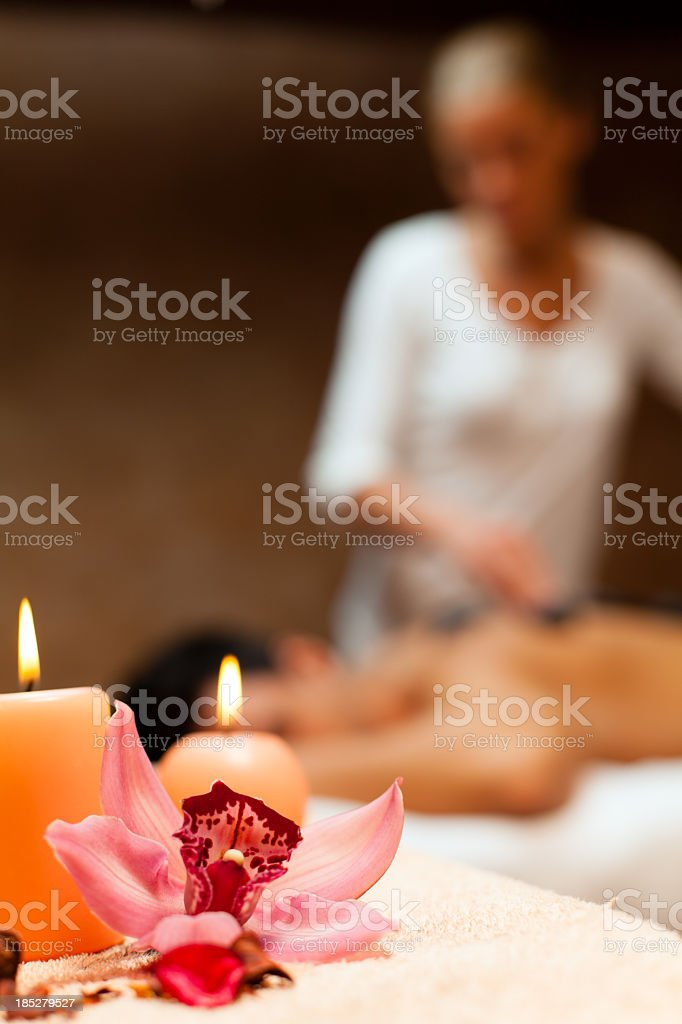 Candles and orchid on massage table royalty-free stock photo