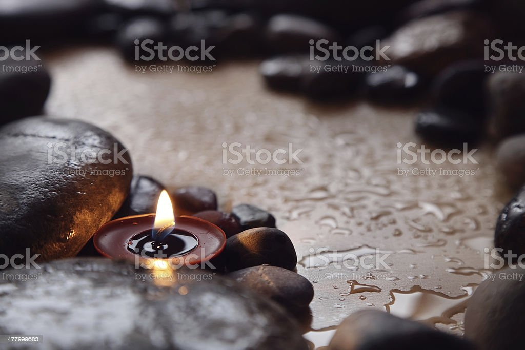 candles and stones stock photo