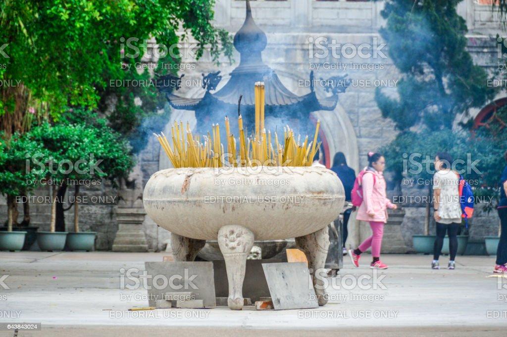 Candles burn at Buddhist Monastery stock photo