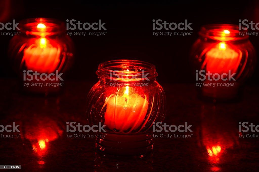 Candles Burning At a Cemetery During All Saints Day stock photo