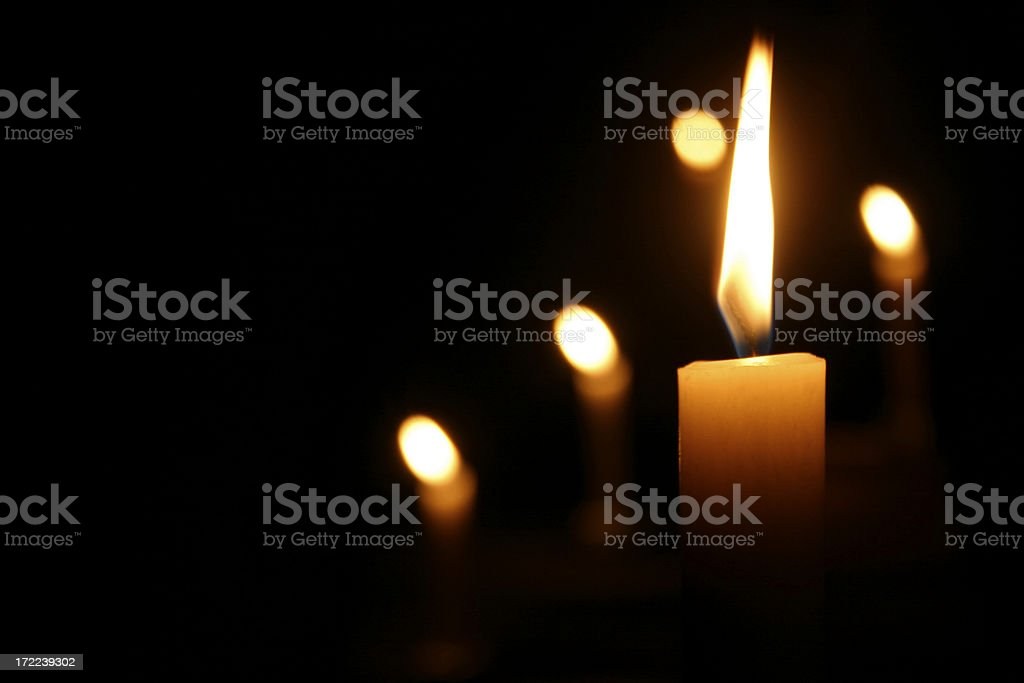 Candles Burning in Dark Church royalty-free stock photo