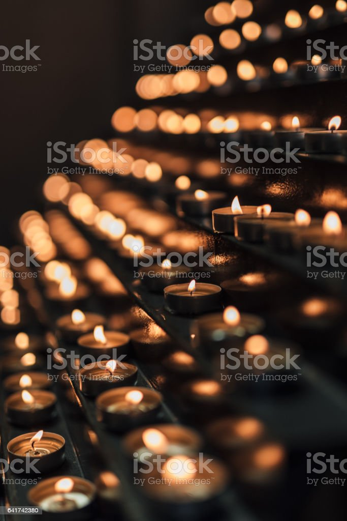 Candles burning in rows stock photo