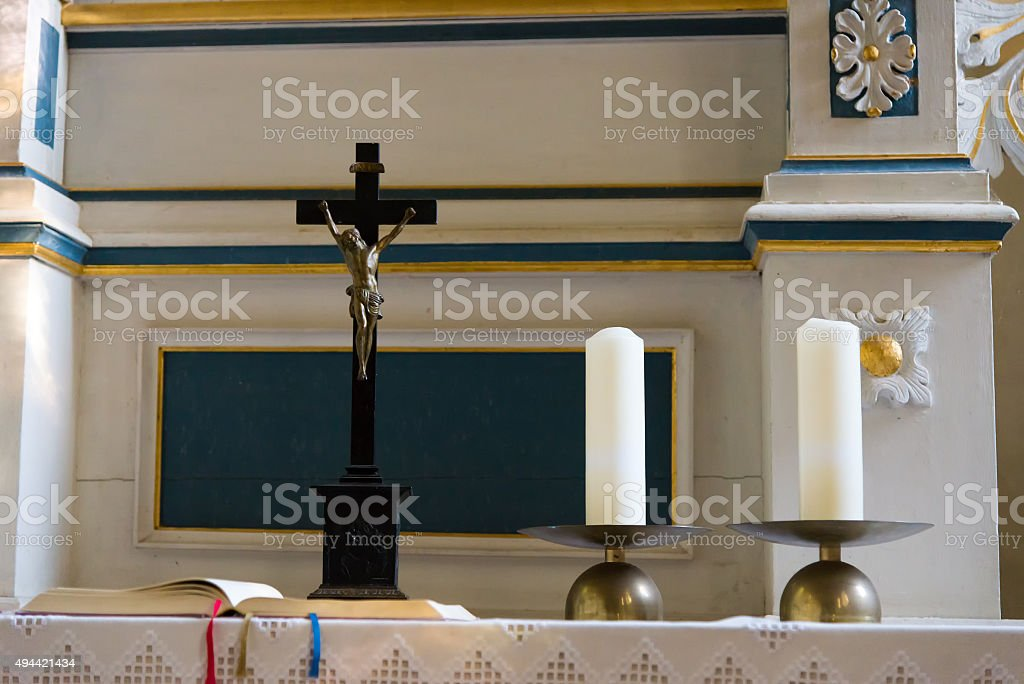 candles, cross and bible on an altar stock photo