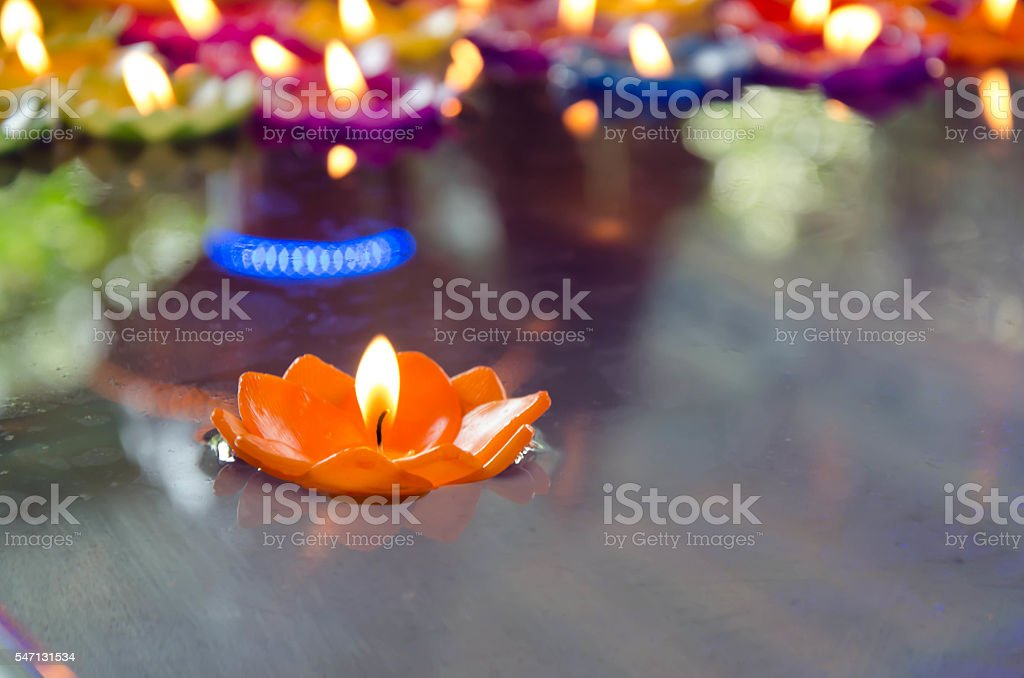 candles floating on water stock photo