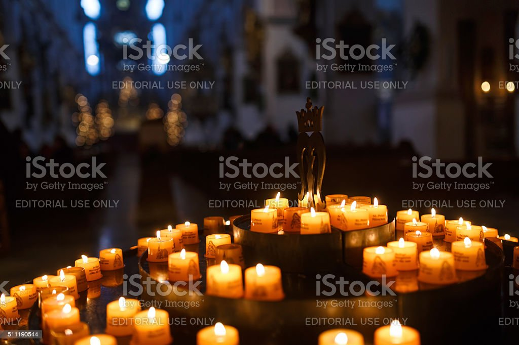 Candles for prayers in church stock photo