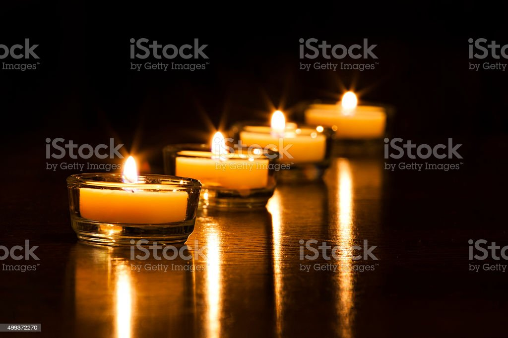Candles four stock photo