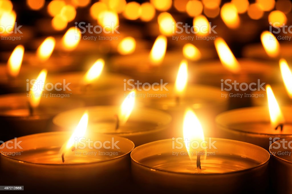 Candles glowing in the dark stock photo