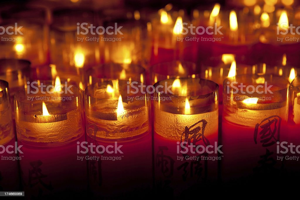 Candles in a buddhist temple royalty-free stock photo