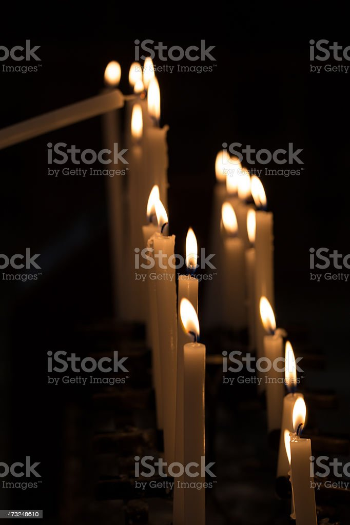 Candles in a Church, Black Background stock photo